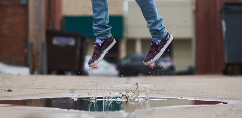 resilience woman jumping puddle